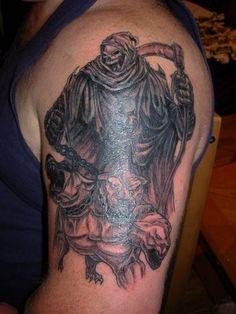 Grim reaper with dog cerberus tattoo