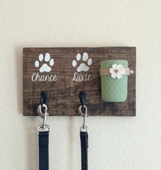 Wooden leash holder- Consider Nora's actual paw prints? Treat holder painted aqua w hemp rim & paper flower(or dried flower?) Consider a second mason jar that dispenses poop bags through small hole in lid.