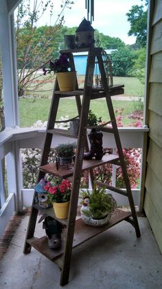 Old wooden ladder used on porch...cute