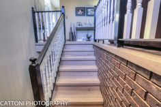 The entry of this beautiful Home features Lauzon Flooring Fifth Avenue Wire Brushed hardwood flooring from the Urban Loft Series. #interiordesign #hardwoodfloor #artfromnature #stairs #entry #hall