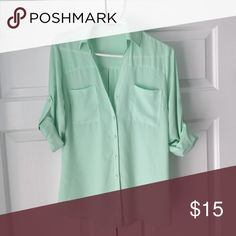 Express Portofino Shirt Gently used semi-sheer XS in mint green. Adjustable cuffs and loose fit make this a cute casual piece work for any wardrobe! Express Tops Button Down Shirts
