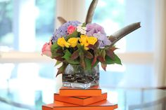 I've saved Hermes boxes and ribbons throughout the years. The Hermes box is very pretty and chic. So I stacked these boxes up to be the base for my floral arrangement.