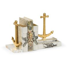 Gold Anchor Bookends With Acrylic Base ($403) ❤ liked on Polyvore featuring home, home decor, small item storage, gold home accessories, gold bookends, gold home decor and gold book ends