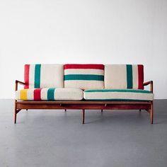 Mid-century modern Teak frame sofa by Danish architect and furniture designer Ib Kofod-Larsen, with new cushions upholstered in deadstock Hudson Bay blankets.
