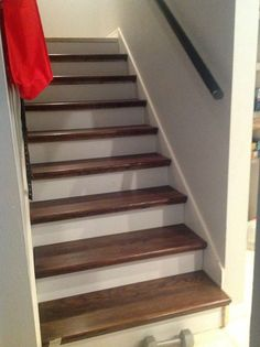 How to redo stairs for cheap - Give your outdated staircase a gorgeous new look! This is a cheater version (little scraping / little painting) that uses wood caps on top of your existing stairs.