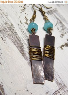 "Beautiful Amazonite adorn these brass earrings. They have textured brass bar drops and they are wrapped with raw brass wire for that #rustic look.   •Earring measures 3"" ➡️ https://www.etsy.com/listing/254147042/sale-bar-earrings-woodland-gemstone-boho?utm_campaign=products&utm_content=66d3e07bf58245b08b72197dd8366454&utm_medium=pinterest&utm_source=sellertools"