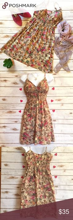 Floral Print 100% Cotton Sun Summer Dress This is so pretty! Elastic right under the bust line and padded cups make this a sexy little number. Wear it for Valentine's Day and all throughout the summer. Adjustable spaghetti straps. Size S, measures 12 inches across where the elastic is (without stretching it) and 31 inches in length. She's Cool Dresses