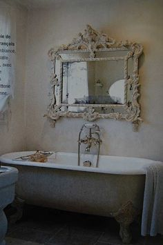 Shabby Chic Bathroom. You can achieve this look by reusing and recycling or using antique pieces.