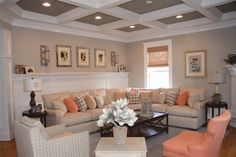 Using a base of cream and accents of gray and coral, we mixed color and pattern throughout this livable living room giving it a casual class.