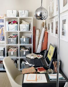 Use Bins to Organize  If you lack closet space, create your own freestanding storage unit. Interior designer Melissa Warner chose an open shelf with metal locker baskets to keep fabric swatches organized and out of the way.