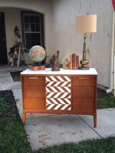 Mid century Danish dresser completely restored. Body is Annie Sloan pure white with a herringbone design on the drawers and the wood has been re stained for a new modern look. This piece was done by Vikki at Uniqueantweaks