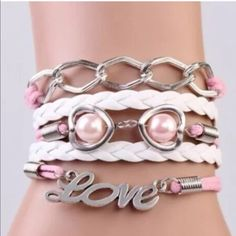 Pink love heart infinity bracelet bindle 2/$12. Infinity bracelet as pictured colors May look different on bracelet than picture shows. Sometimes it is hard to get an accurate picture. Bundle with another bracelet 2/$12 Jewelry Bracelets