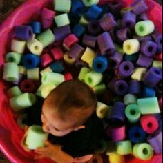 Ball/Foam Pit. Small plastic pool plus cut up pool noodles! Less than $15. The girls might be too old for this now, but it's a super cute idea for a future baby... Or maybe a 2nd birthday gift for a cute lil boy next summer....? @Hollee Han