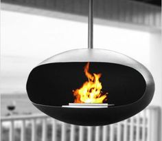 Cocoon Aeris Black fireplace is a round modern hanging fireplace that burns clean fuel and is height adjustable. Hanging Fireplace, Black Fireplace, Fireplace Design, Decorating Your Home, Interior Decorating, New Condo, Wood Ceilings, Home Decor Furniture, Hearth