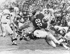 In this Jan. 15, 1967, file photo, Green Bay Packers' Klijah Pitts (22) goes over right tackle to the Kansas City Chiefs' five-yard line, for a six-yard gain before being brought down by Kansas City's Johnny Robinson in the fourth quarter of Super Bowl I in Los Angeles.
