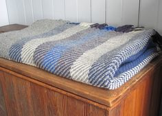 Wool Twill Blanket, Handwoven, Seaside Cottage or Rustic Cabin Style, Nautical Stone Gray, Ivory, Ocean Blue. $725.00, via Etsy.