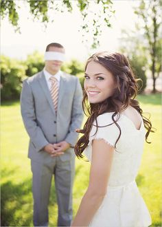 Blindfolded groom and his blushing bride.