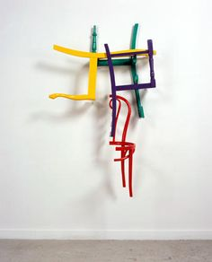 Jim Lambie, Untitled, 2007 Wooden chairs and gloss paint 34 1/4 x 78 3/4 x 49 1/4 inches