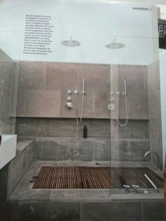 Sunken bath which is also a shower! Brilliant