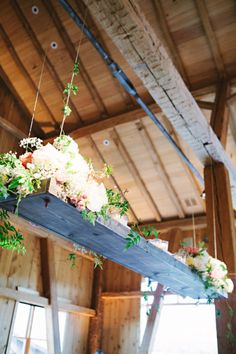 Hanging flower box for a rustic reception