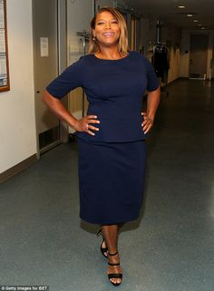 Look who was backstage: Queen Latifah proudly posed in a navy top and skirt set behind-the...