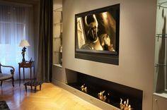 Salon télé équipé d'une enceinte conçu sur-mesure, intégrée au mur. Système Blu-Ray - Home Cinema intégré. Réalisation DSR (Lyon 2ème)