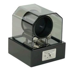 Orbita Futura Single Automatic Watch Winder - Mains or Battery - New / In Presentation Box - RRP £530; Save £150  Brand New Single Orbita Futura Watch Winder for automatic watches. This modern and very stylish single watch winder has a stainless-steel drum sat on a stainless steel platform, a piano black base and an attractive formed acrylic dust cover to protect the watch. An ironless core Swiss micro-motor is concealed within one of the two stainless steel support rollers.
