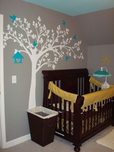 Three of my favorite baby decorations!  Wall decals, gray paint and a yellow/turquoise combo!
