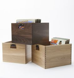 """Whether storing new finds or favorite titles that are in heavy rotation, our Record Crate is the perfect way to store up to 100 LPs in a portable, beautifully crafted crate. Each crate is handcrafted from 5/8"""" thick locally sourced solid wood and features exposed English dovetail joinery for both beauty and strength. Vegetable tanned leather handles with solid brass fasteners lend comfortable support when moving full crates and add an elegant and functional detail.  * Oak or Walnut with…"""