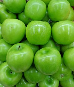 pile of vibrant color green apples