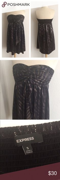 "Express sparkly dress Express sparkly cocktail dress. Size S. Measures just shy of 29"" long with a 28"" bust (the whole is elastic so it stretches well beyond that). Bust stretches comfortably to about 36"". Silver sparkle. 92% polyester/ 8% spandex. EUC.  🚫NO TRADES🚫 💲Reasonable offers accepted💲 💰Great bundle discounts💰 Express Dresses Mini"