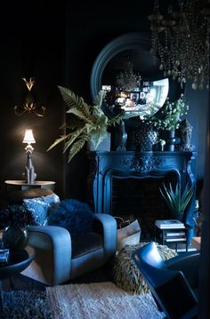 Blue living room, indoor plants, blue walls, decorating with blue, hollywood regency living room, elegant living room, fireplace, antique decorating, blue chair