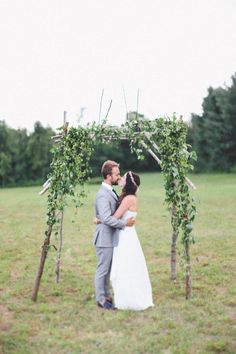 Natural wedding ceremony arch | Photo by Meg Haley
