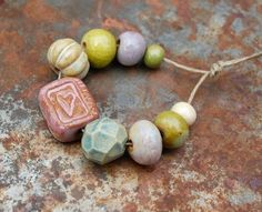 Sweet love… Ceramic heart bead set in pinks and greens. The original! Gaea Ceramic Bead and Art Studio Blog / gaea.cc