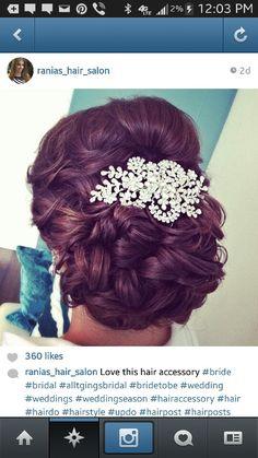 Soft Bridal updo with large crystal hairpiece #weddinghair #raniahairsalinandspa