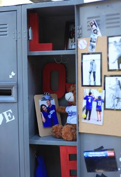 The bride and groom were high school sweethearts, so they chose this set of steel lockers to serve as the card box for their baseball themed wedding.  One locker was locked and modified with a card slot, the other was left open and decorated with mementos.  Awesome idea!  #baseballwedding
