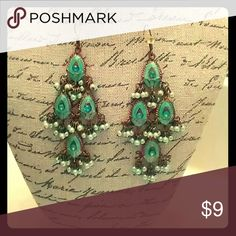 Peacock inspired chandelier earrings Teal and gold with blue sparkles and little teal pearls.  Elegant and fun.  Fishhooks with rubber stoppers.  I'm open to offers and happy to discount on bundles. Jewelry Earrings