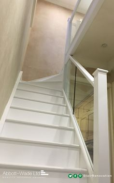 Full white staircase with glass balustrade
