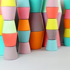 Bright-coloured plant pots: pop a cactus in one for a perfect Xmas gift!