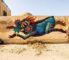 http://streetiam.com @Curiotli signature Street Art mythical creature mural in Djerba, Tunisia