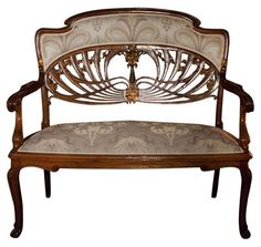 Furniture: Art Nouveau furniture seems fairytale-ish, and is very unique. The the circular design on the backrest of the bench flows gracefully with the rest of the ornate design. Móveis Art Nouveau, Art Nouveau Interior, Design Art Nouveau, Art Nouveau Furniture, Furniture Styles, Furniture Design, Furniture Market, Furniture Buyers, Street Furniture