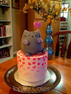 Pusheen the cat cake. Kitty cat cake.  Confetti hearts.  Made by Amber Adamson of Top Tier Cakes in East Wenatchee, WA.  Come find me on Facebook!!