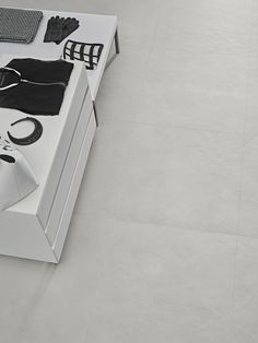 Edge a concrete look porcelain tile from Florida Tile. Floor and Wall tile. Flooring.      Products: Edge, Silver