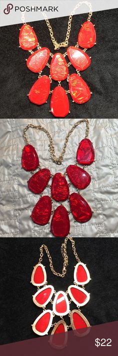 "Necklace Red and gold tone. Necklace Red and gold tone.  In the light the stones shines with designs inside the stone.  Approximately 16"" around neck with a 3"" extension.  Stones are 4"" tall x 6"" wide at the top. Never been worn. Jewelry Necklaces"