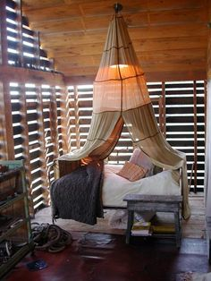 J. Morgan Puett. I can't resist a bed canopy. Especially coupled with bare wood and diffuse light!