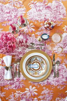 """Easter brunch is a fun and festive occasion, and while the typical bunny and egg themed decor is great, you can always up the level of sophistication by incorporating luxurious (and colorful!) fabrics into a decorative table. Manuel Canovas gave an edge to this traditional toile with a fabulous fuchsia/orange color combination."" Anne Hepfer"