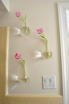 Ohh it's Magic!  Floating Vases! (You can by them here:  http://www.cb2.com/vases/accessories/wall-mounted-teardrop-vase/f2906)