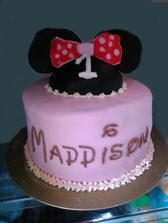 Cake for a 1 year old girl who has a mother who adores Disney! Large 3 tier cake vanilla cake with an extra top cake to make the mini ears, all decorated in marshmallow fondant with vanilla butter-cream