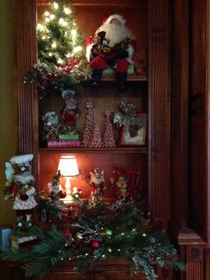 Bookcase is ready for Christmas, dressed with my Santa and fairies!