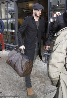 Doting husband: David Beckham arrived in Paris to spend the weekend with his wife Victoria on Friday